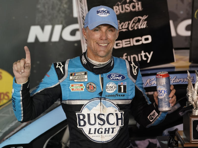 Kevin Harvick celebrates in Victory Lane after winning the NASCAR Cup Series auto race Saturday, Sept. 19, 2020, in Bristol, Tenn. (AP Photo/Steve Helber)
