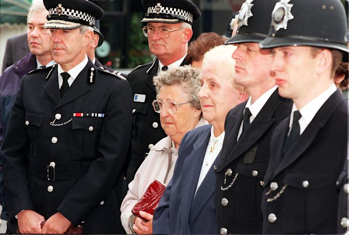Then Met Police Commissioner Sir Paul Condon (left) stands with Liz Blakelock (glasses), the mother of murdered policeman Keith Blakelock, at his funeral in 1985 (GETTY)