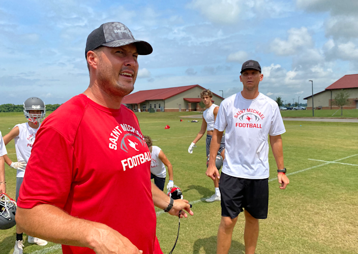 Retired NFL quarterback Philip Rivers and younger brother Stephen are coaches at St. Michael Catholic High in Fairhope, Ala.