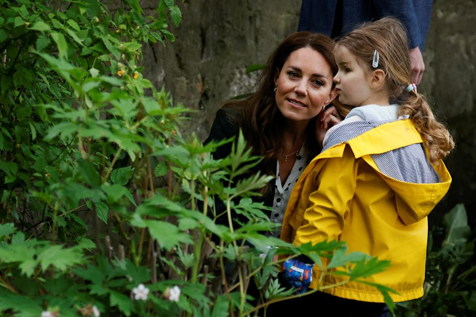 Britain's Catherine, Duchess of Cambridge interacts with a child from Edzell Nursery as she visits Starbank Park to hear about the work of Fields in Trust, along with Britain's Prince William, Duke of Cambridge, in Edinburgh, Scotland on May 27, 2021. (Photo by PHIL NOBLE / POOL / AFP) (Photo by PHIL NOBLE/POOL/AFP via Getty Images)