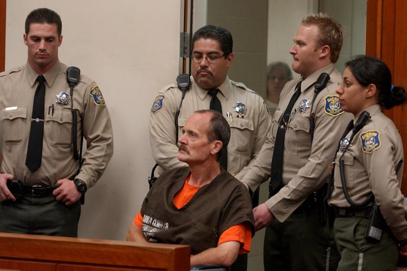 FILE - In this Thursday, May 13, 2004 file photo, Curtis Dean Anderson is surrounded by sheriff deputies as he listens to a judge during his arraignment in a San Jose, Calif., courtroom. Anderson, convicted of kidnapping and murdering the 7-year-old girl, also claimed to have killed several young women in California, so the FBI is now asking for help in identifying those alleged victims. (AP Photo/Paul Sakuma, file)