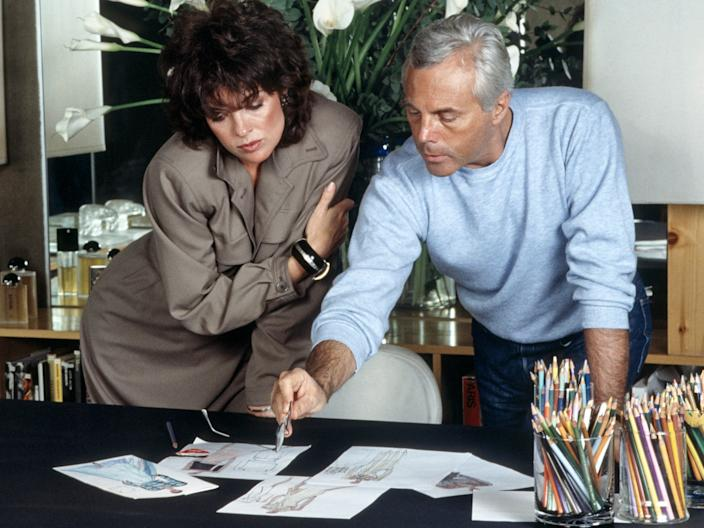 "Armani showing some sketches to American actress Linda Gray in 1983. <p class=""copyright"">Getty Images</p>"
