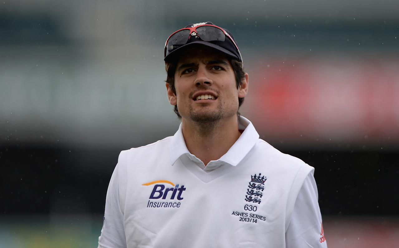 HOBART, AUSTRALIA - NOVEMBER 09:  England captain Alastair Cook leaves the field for a rain break during day four of the tour match between Australia A and England at Blundstone Arena on November 9, 2013 in Hobart, Australia.  (Photo by Gareth Copley/Getty Images)