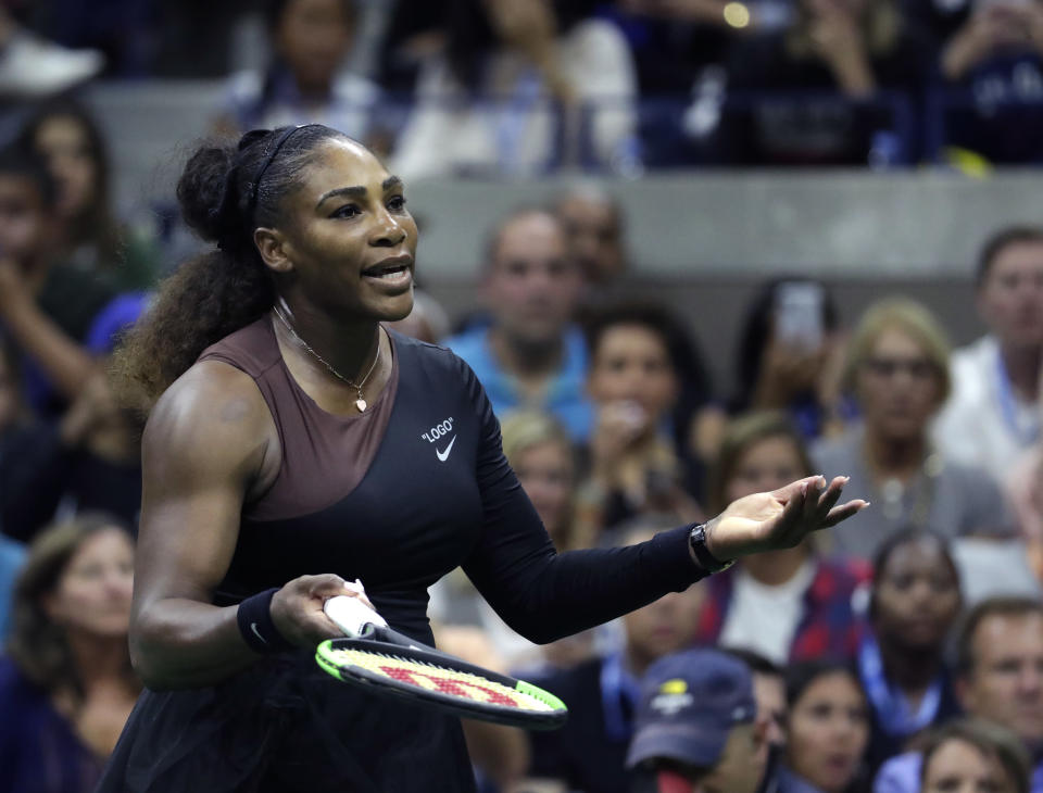 Virgil Abloh designed Serena Williams' U.S. Open attire, which features quotations just as her Woman of the Year cover does. (AP Photo/Julio Cortez)