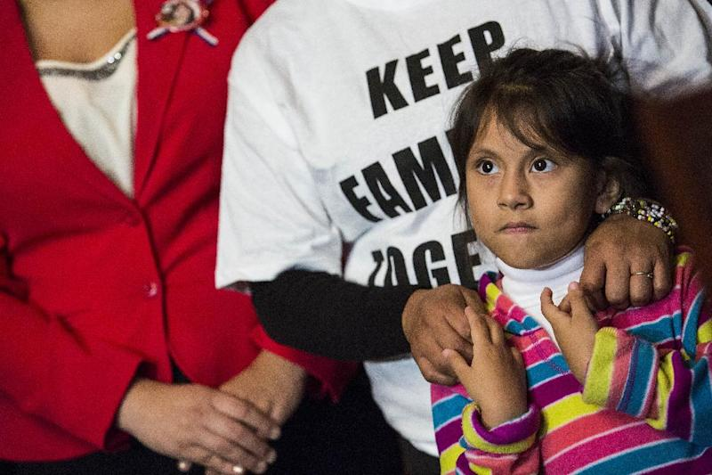 Families from Mexico, now living in Maryland, attend a news conference with Democratic Senators to discuss US President Barack Obama's executive order on immigration, in Washington, DC, on December 10, 2014 (AFP Photo/Drew Angerer)