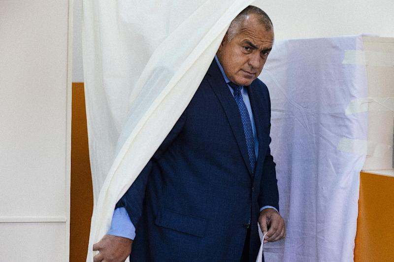 Bulgarian strongman Boyko Borisov and GERB party leader steps out of a ballot booth before voting at a polling station during the general election in Sofia on October 5, 2014 (AFP Photo/Dimitar Dilkoff)