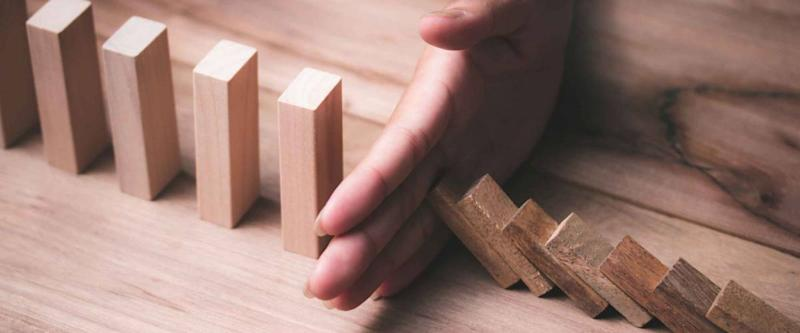 Stopping dominoes