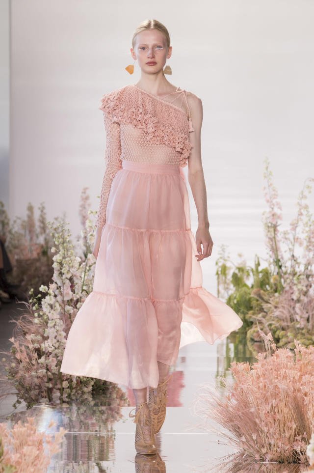 <p><i>Model wears a pastel pink, ruffled, one-shoulder dress from the SS18 Ulla Johnson collection. (Photo: ImaxTree) </i></p>