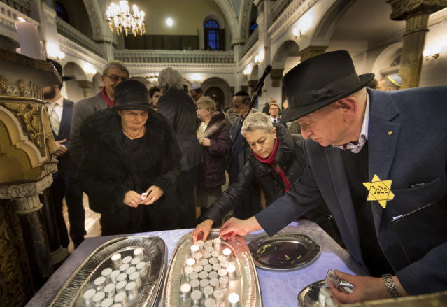 <p>Lithuanian Jews light candles during a commemoration ceremony on International Holocaust Remembrance Day, in the Synagogue in Vilnius, Lithuania, Thursday, Jan. 26, 2017. (Photo: Mindaugas Kulbis/AP) </p>