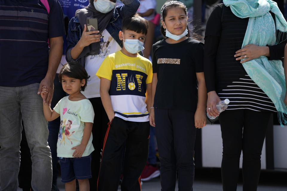 Afghan refugees wearing face masks to prevent the spread of the coronavirus, board an airplane bound for Portugal at the Eleftherios Venizelos International Airport in Athens, on Tuesday, Sept. 28, 2021. The 41 refugees from Afghanistan were relocated as part of a migrant reunification plan agreed between the two countries. (AP Photo/Thanassis Stavrakis)