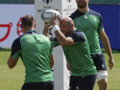 Ireland rugby team captain Rory Best prepares to pass the ball during training for their Rugby World Cup Pool A game at the Fukuoka Hakatanomori Stadium in Fukuoka, Japan, Friday, Oct. 11, 2019. Ireland will play against Samoa Oct. 12 in Fukuoka while games against England and France in Yokohama and the match between New Zealand and Italy at Toyota city have been cancelled due to the upcoming Typhoon Hagibis. (AP Photo/Aaron Favila)