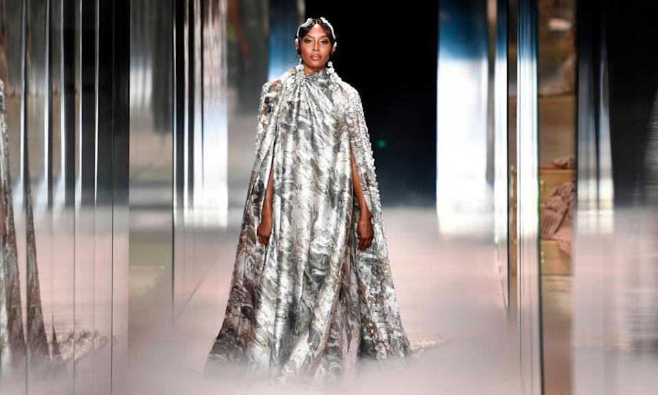 Naomi Campbell closed the show in a silver cape.