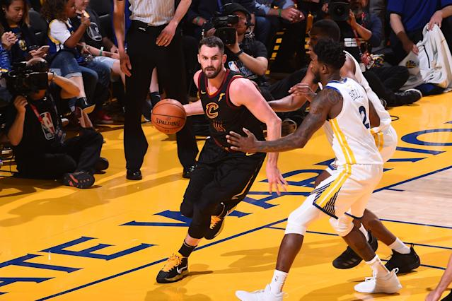 Kevin Love works against the Warriors in Game 1 of the NBA Finals on Thursday night. (Getty Images)