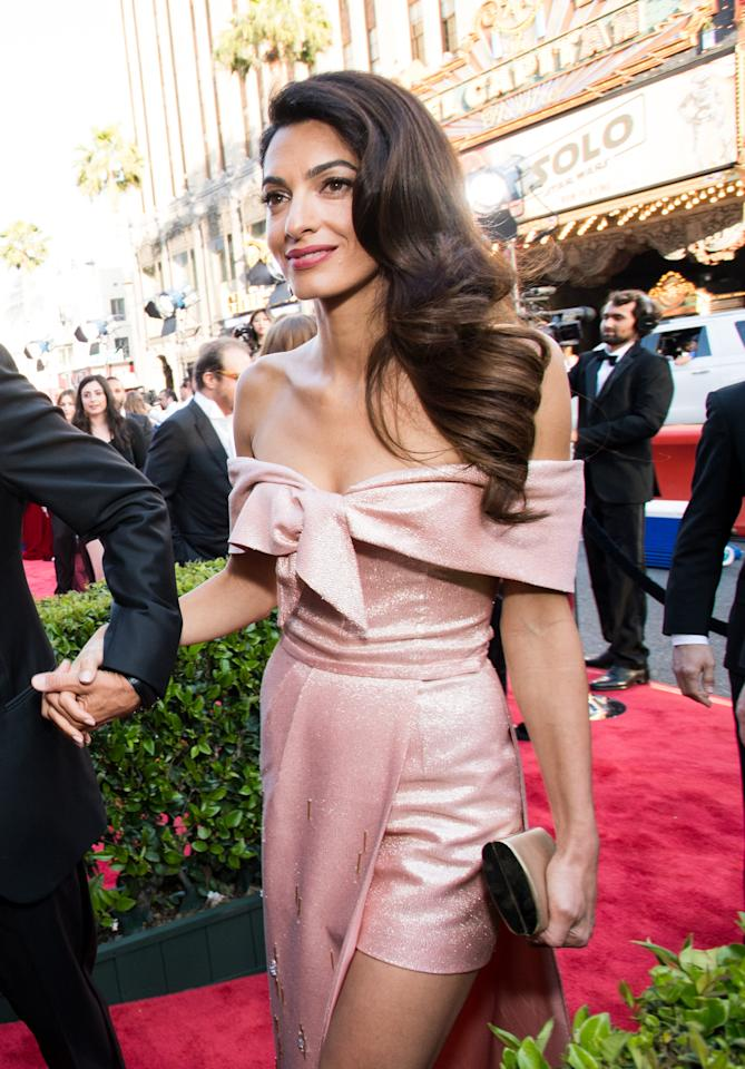 <p>At the American Film Institute Awards in Los Angeles, Amal demonstrated her sartorial prowess in a cold-shoulder powder pink dress courtesy of Prada. How great does she look? <em>[Photo: Getty]</em> </p>