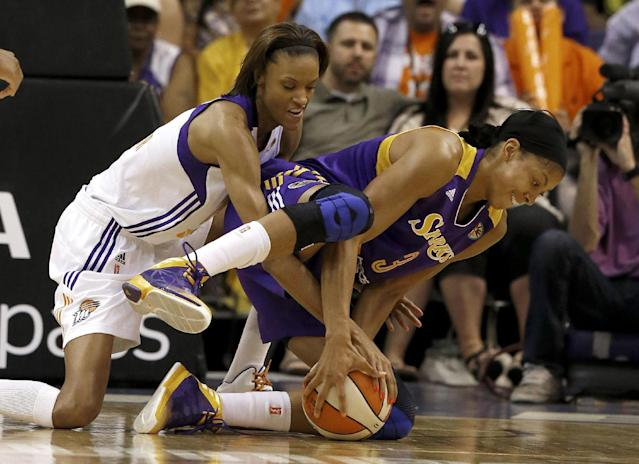 Phoenix Mercury's DeWanna Bonner, left, battles Los Angeles Sparks' Candace Parker for the loose ball during the first half in a WNBA basketball game on Friday, June 14, 2013, in Phoenix. (AP Photo/Ross D. Franklin)