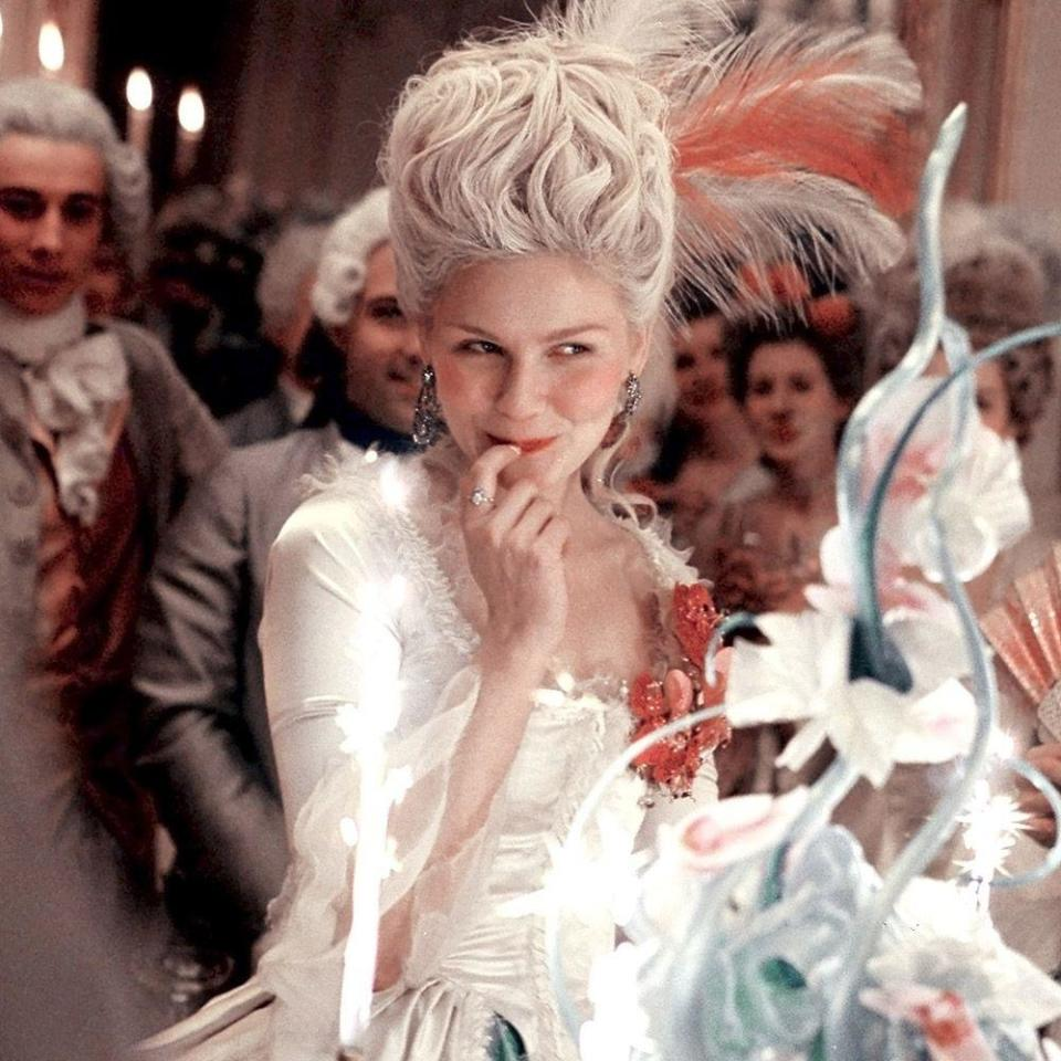 """<p>If a film's essence could be summed up in a playlist, Sofia Coppola's historically reimagined <em>Marie Antoinette</em>, which juxtaposes a punk attitude with a palette of millennial pinks and pretty pastels, would be a new-wave rock-and-roll punk dream. By infusing her period-piece narrative with tracks like Bow Wow Wow's """"<a href=""""https://www.youtube.com/watch?v=MqfZ04I9DOk"""" rel=""""nofollow noopener"""" target=""""_blank"""" data-ylk=""""slk:Aphrodisiac"""" class=""""link rapid-noclick-resp"""">Aphrodisiac</a>,"""" The Strokes' """"<a href=""""https://www.youtube.com/watch?v=k3qgrSon4To"""" rel=""""nofollow noopener"""" target=""""_blank"""" data-ylk=""""slk:What Ever Happened?"""" class=""""link rapid-noclick-resp"""">What Ever Happened?</a>"""" and Siouxsie and The Banshees' """"<a href=""""https://www.youtube.com/watch?v=7X9HojJ6N5I"""" rel=""""nofollow noopener"""" target=""""_blank"""" data-ylk=""""slk:Hong Kong Garden"""" class=""""link rapid-noclick-resp"""">Hong Kong Garden</a>,"""" there's a rebellious streak running through this 2006 gem that teens from any time period can relate to. History be damned when the music is this good.</p><p><a class=""""link rapid-noclick-resp"""" href=""""https://www.amazon.com/Marie-Antoinette-Kirsten-Dunst/dp/B000NGYLOM?tag=syn-yahoo-20&ascsubtag=%5Bartid%7C10056.g.32872244%5Bsrc%7Cyahoo-us"""" rel=""""nofollow noopener"""" target=""""_blank"""" data-ylk=""""slk:Watch and Listen"""">Watch and Listen</a></p>"""