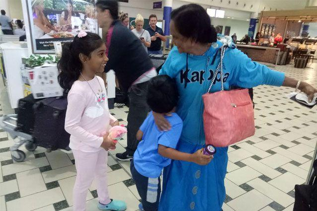 Ms Lakshmi's grandchildren were there to meet her at Brisbane Airport, ready to celebrate her 65th birthday. Source: Supplied