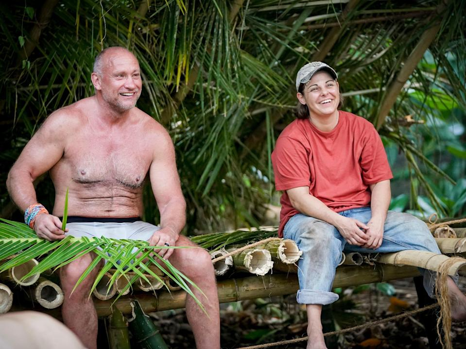 Tom Laidlaw and Elaine Stott sitting in a hut made of leaves on survivor