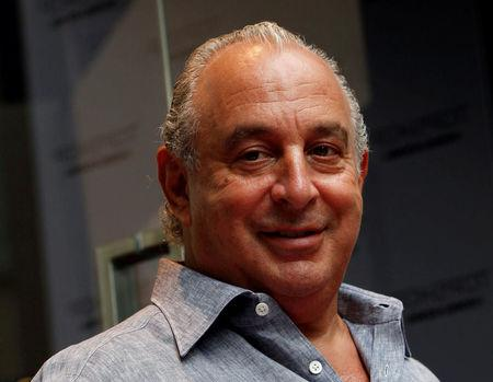 FILE PHOTO:British billionaire and CEO of the Arcadia Group Philip Green smiles as he attends the opening ceremony of a Topshop flagship store in Hong Kong June 6, 2013. REUTERS/Bobby Yip/File Photo