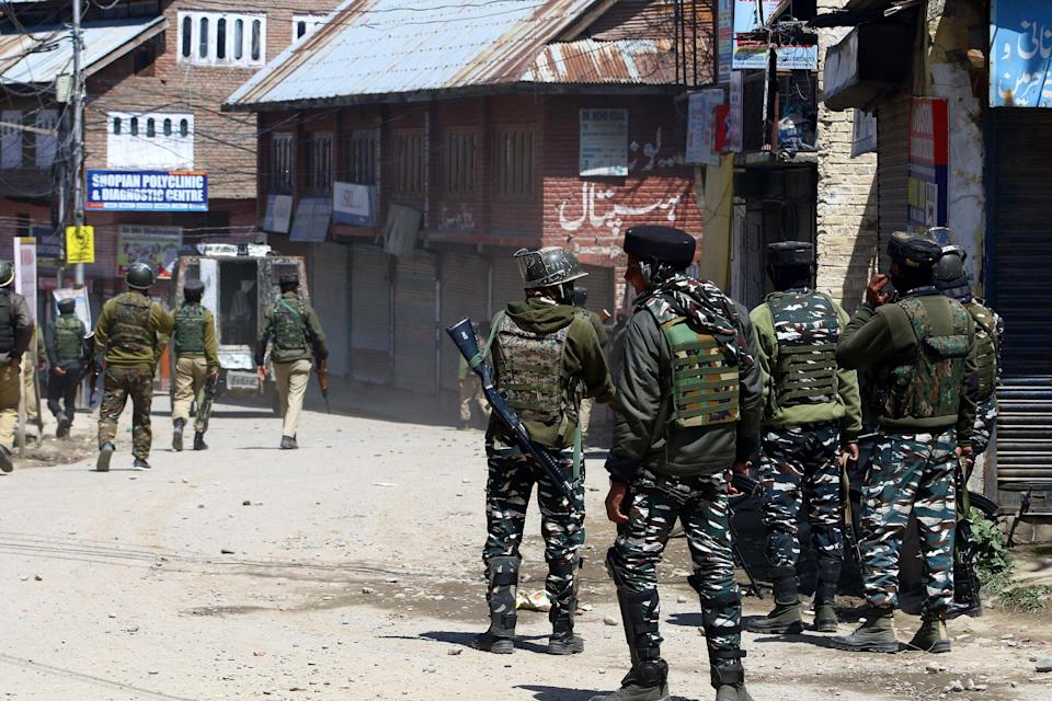 Security forces chases stone pelters during gunfight at Shopian