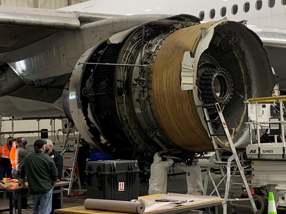 <p>The damaged starboard engine of United Airlines flight 328, a Boeing 777-200, is seen following a February 20 engine failure incident, in a hangar at Denver International Airport in Denver, Colorado, on 22 February 2021</p> ((Reuters))