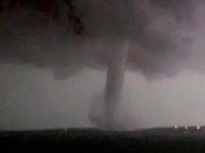 This 20 October 2019 image made from video by Twitter user @AthenaRising shows the tornado in Rockwall, Texas. The National Weather Service confirmed a tornado touched down in Dallas on Sunday night, causing structural damage and knocking out electricity to thousands. (@AthenaRising via AP): AP