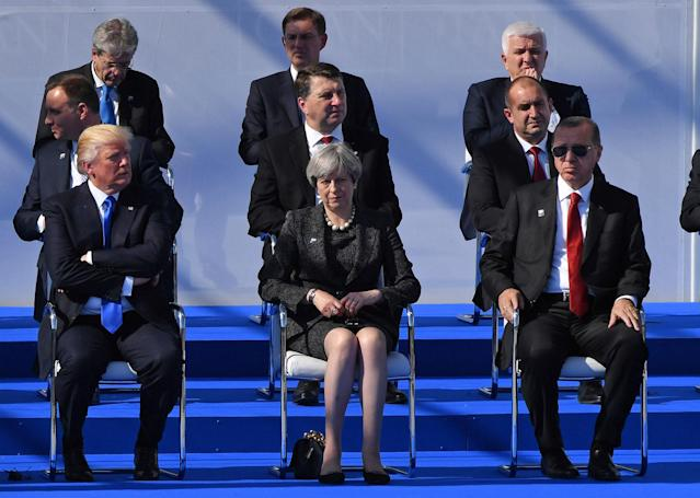 <p>President Donald Trump, left, British Prime Minister Theresa May and Turkish President Recep Tayyip Erdogan, front row, during a ceremony at the NATO summit in Brussels on Thursday, May 25, 2017. US President Donald Trump and other NATO heads of state and government on Thursday will inaugurate the new headquarters as well as participating in an official working dinner. (AP Photo/Geert Vanden Wijngaert, Pool) </p>