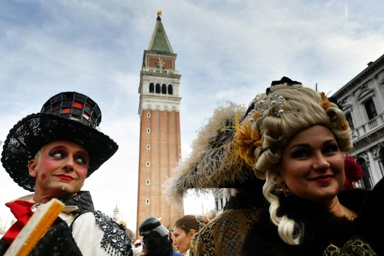 Revellers in costume turned out for the start of the Venice Carnival (AFP Photo/Alberto PIZZOLI)