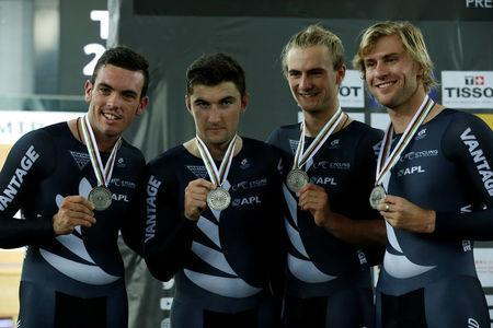 Cycling - UCI Track World Championships - Men's Team Pursuit, Final - Hong Kong, China – 13/4/17 - Team New Zealand celebrate with silver medals. REUTERS/Bobby Yip