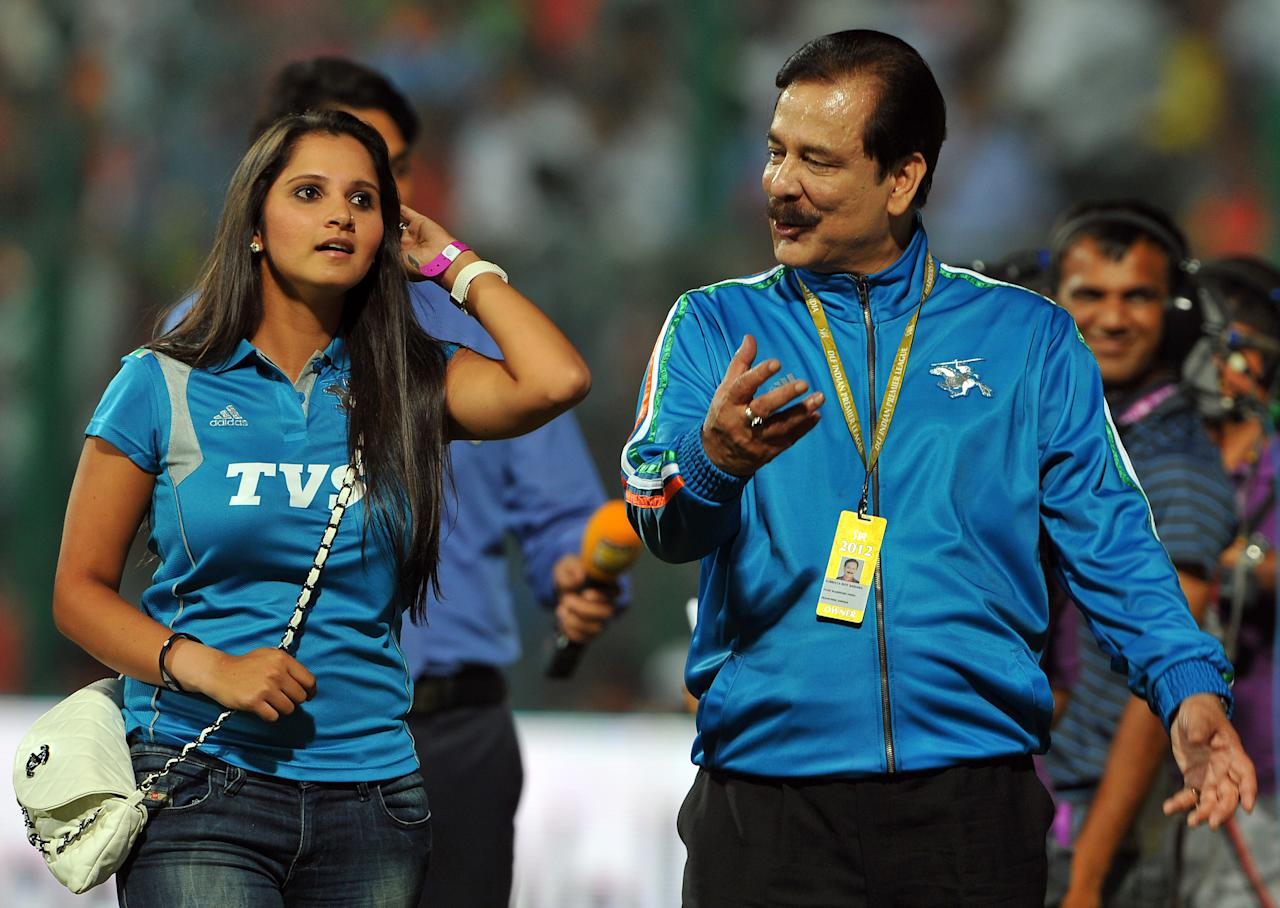 Sahara Force India formula car racing team and Pune Warriors team owner Subroto Roy Sahara (R) and Indian tennis player Sania Mirza walk back to the stands prior to the start of the IPL Twenty20 cricket match between Royal Challengers Bangalore and Pune Warriors at the M. Chinnaswamy Stadium in Bangalore on April 17, 2012.   RESTRICTED TO EDITORIAL USE. MOBILE USE WITHIN NEWS PACKAGE.   AFP PHOTO/Manjunath KIRAN (Photo credit should read Manjunath Kiran/AFP/Getty Images)