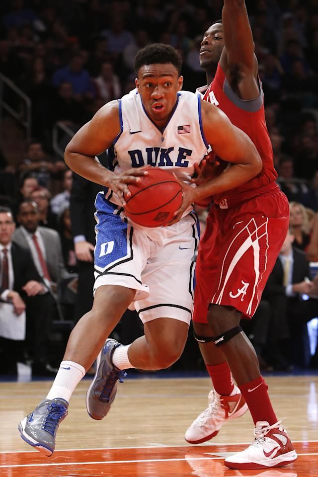 Duke's Jabari Parker, left, drives to the basket against Alabama's Rodney Cooper, right, during the first half of an NCAA college basketball game in the semifinals of the NIT Season Tip-off tournament Wednesday, Nov. 27, 2013, in New York. (AP Photo/Jason DeCrow)