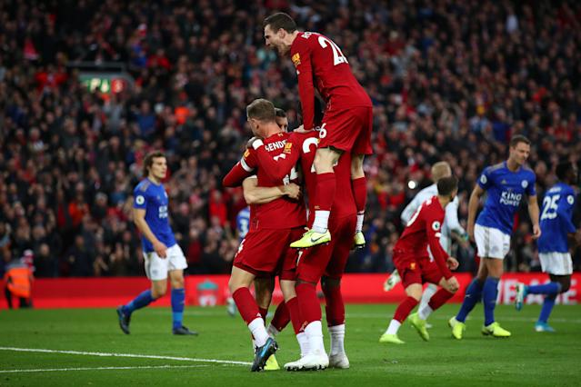 Liverpool players celebrate with match-winner James Milner. (Photo by Clive Brunskill/Getty Images)