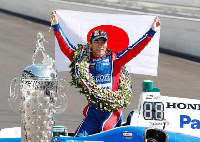 Verizon IndyCar Series driver Takuma Sato poses with a Japanese flag a day after winning the 101st Running of the Indianapolis 500 (Indy 500) at the Indianapolis Motor Speedway in Indianapolis, Indiana, U.S. May 29, 2017. Mandatory Credit: Brian Spurlock-USA TODAY Sports TPX IMAGES OF THE DAY