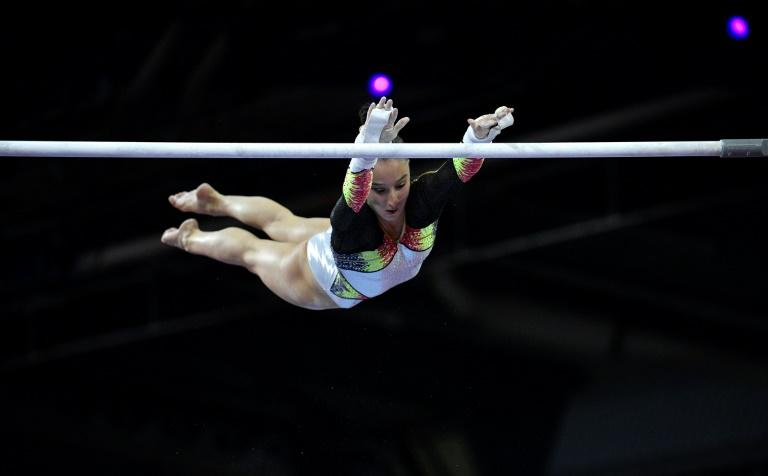 Belgium's Nina Derwael performs on the uneven bars on the way to retaining her title at the world gymnastics championships in Stuttgart