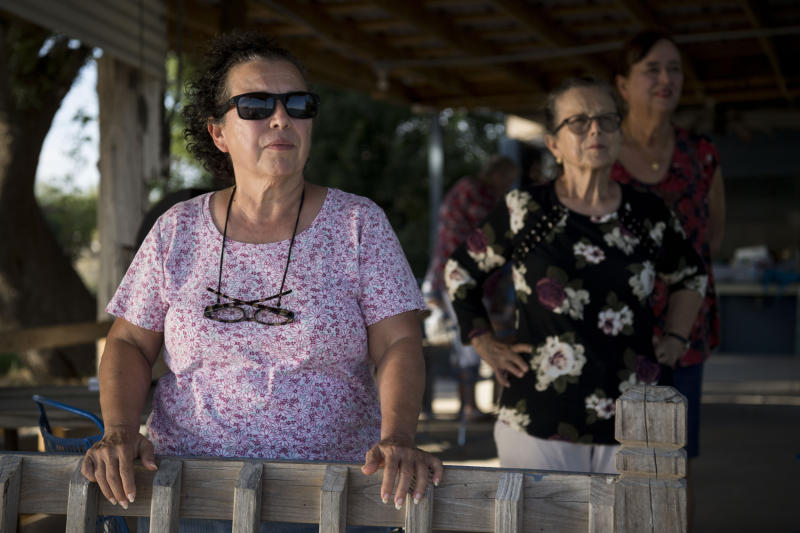 MISSION, TX - AUGUST 22: Norma Anzaldua stands with her family watching the Rio Grande river on her family's land on August 22, 2018 in Mission, Texas. (Photo by Carolyn Van Houten/The Washington Post via Getty Images)