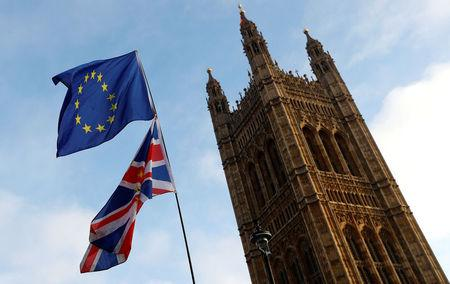 Protesters wave the EU and Union flags outside the Palace of Westminster, London