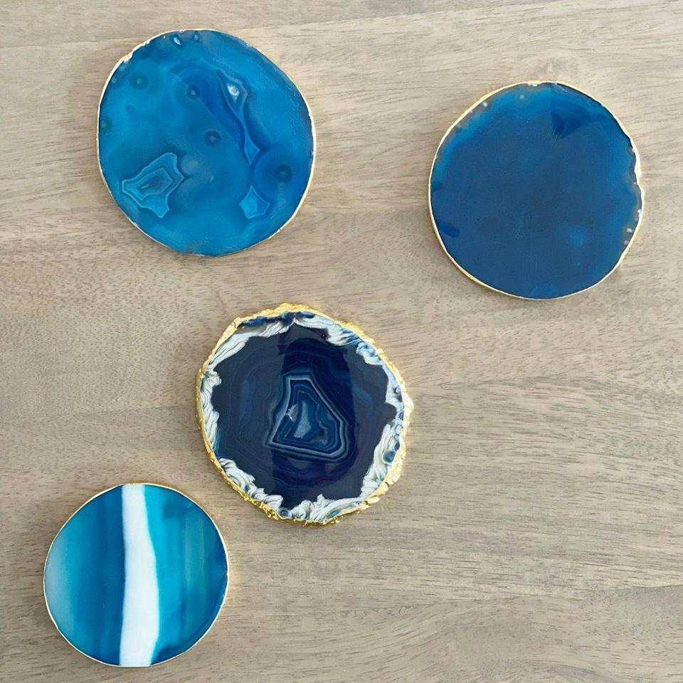 """<p>teaandlinen.com</p><p><strong>$40.00</strong></p><p><a href=""""https://www.teaandlinen.com/products/blue-agate-coasters-set-of-4"""" rel=""""nofollow noopener"""" target=""""_blank"""" data-ylk=""""slk:BUY NOW"""" class=""""link rapid-noclick-resp"""">BUY NOW</a></p><p>If you're into a laidback approach to gift-giving, bring over a bottle of wine with a beautiful coaster set. It's personal and lowkey.</p>"""