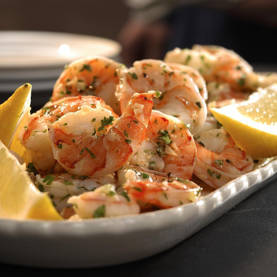 <p>Marinating precooked shrimp in garlic- and lemon-infused oil is a simple yet elegant appetizer.</p>