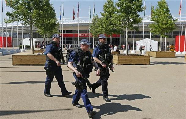 Armed police officers patrol outside the main dining hall inside the London 2012 Olympic Games Village in Stratford, east London July 24, 2012.