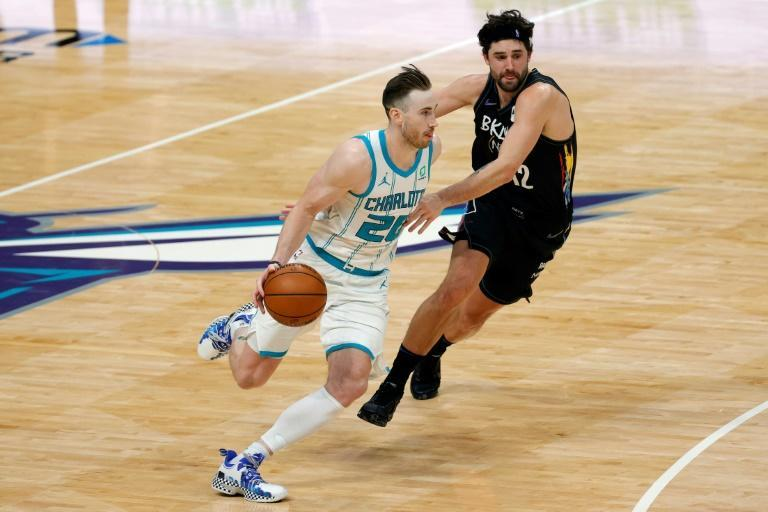 Charlotte's Gordon Hayward drives to the basket against Brooklyn's Joe Harris in the Hornets' 106-104 NBA win over the Nets