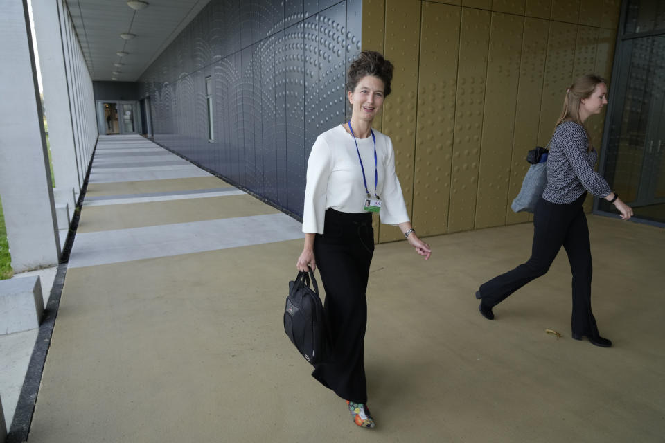 Arlette Schijns, one of nine lawyers for relatives of victims of the MH17 crash, arrives at the court for the trial of four men charged with murder over the downing of Malaysia Airlines flight MH17, at Schiphol airport, near Amsterdam, Netherlands, Monday Sept. 6, 2021. Relatives of some of the 298 people killed in the downing of Malaysia Airlines flight MH17 tell a Dutch court about the impact on their lives of the disaster during the trial of three Russians and a Ukrainian charged with involvement in bringing down the Amsterdam-Kuala Lumpur flight more than seven years ago. (AP Photo/Peter Dejong)