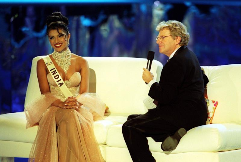 Miss India, Priyanka Chopra, 18, speaking with the host, Jerry Springer, during the Miss World contest at The Millennium Dome in Greenwich. (Photo by Michael Crabtree - PA Images/PA Images via Getty Images)