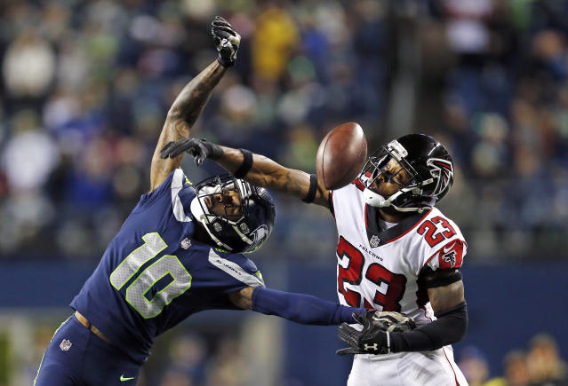 Seattle Seahawks receiver Paul Richardson misses catching the ball against the Falcons on Monday night. (AP)