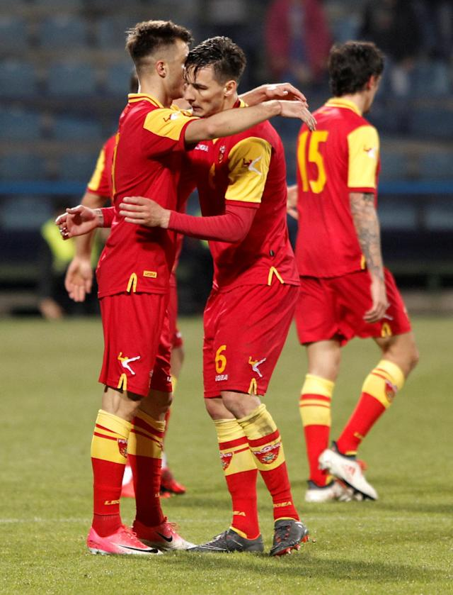 Soccer Football - International Friendly - Montenegro vs Turkey - Podgorica City Stadium, Podgorica, Montenegro - March 27, 2018 Montenegro's Stefan Mugosa celebrates scoring their second goal with Zarko Tomasevic REUTERS/Stevo Vasiljevic