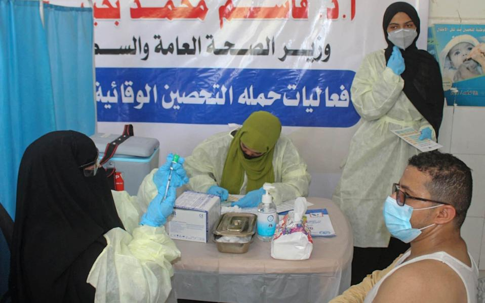 A Yemeni medic prepares a dose of the AstraZeneca COVID-19 vaccine at a vaccination centre in al-Maala district of the southern city of Aden - SALEH OBAIDI/AFP