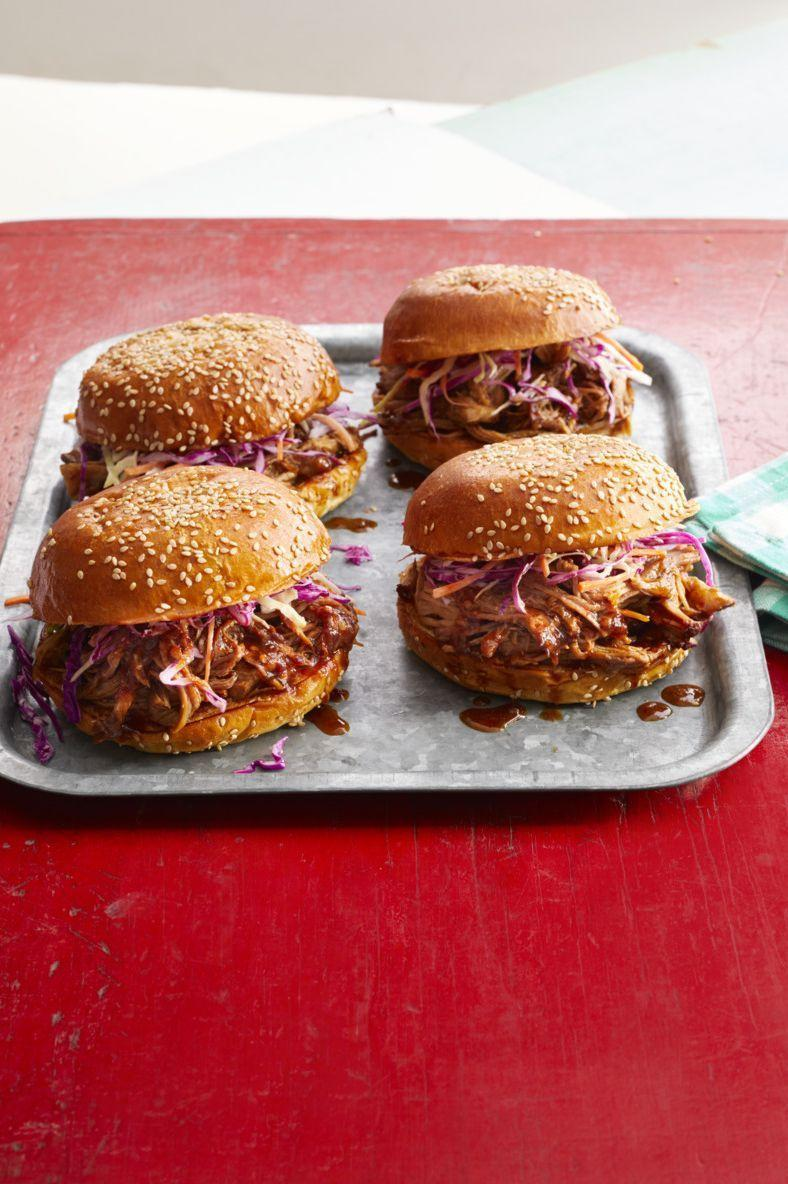 """<p>Enjoy this spicy-sweet shredded pork on a bun with tasty slaw. The secret ingredient is two cans of Dr Pepper.</p><p><strong><a href=""""https://www.thepioneerwoman.com/food-cooking/recipes/a11385/spicy-dr-pepper-shredded-pork/"""" rel=""""nofollow noopener"""" target=""""_blank"""" data-ylk=""""slk:Get the recipe."""" class=""""link rapid-noclick-resp"""">Get the recipe.</a></strong></p><p><strong><a class=""""link rapid-noclick-resp"""" href=""""https://go.redirectingat.com?id=74968X1596630&url=https%3A%2F%2Fwww.walmart.com%2Fbrowse%2Fhome%2Fthe-pioneer-woman-cookware%2F4044_623679_6182459_9190581&sref=https%3A%2F%2Fwww.thepioneerwoman.com%2Ffood-cooking%2Fmeals-menus%2Fg35049189%2Fsuper-bowl-food-recipes%2F"""" rel=""""nofollow noopener"""" target=""""_blank"""" data-ylk=""""slk:SHOP DUTCH OVENS"""">SHOP DUTCH OVENS</a><br></strong></p>"""