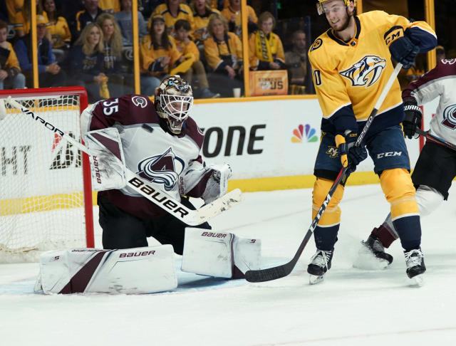 Nashville Predators center Colton Sissons (10) watches as a shot hits Colorado Avalanche goaltender Andrew Hammond (35) during the second period in Game 5 of an NHL hockey first-round playoff series Friday, April 20, 2018, in Nashville, Tenn. (AP Photo/Sanford Myers)