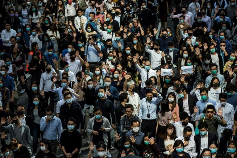 Office workers have regularly taken to the streets in Hong Kong in support of the pro-democracy movement (AFP Photo/ISAAC LAWRENCE)