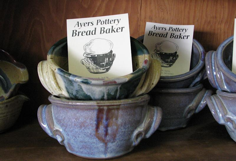 This June 7, 2012, photo shows pottery for sale in Steve Ayers' shop in Hannibal, Mo. When Ayers opened his pottery shop in 1985 he was about the only artist in the riverfront town known mostly for its favorite son, Mark Twain. Twain still is the main draw for the half-million tourists who visit Hannibal each year, but now they get a bonus: A growing number of artists, many of national and international repute. (AP Photo/The Courier-Post, Mary Lou Montgomery)