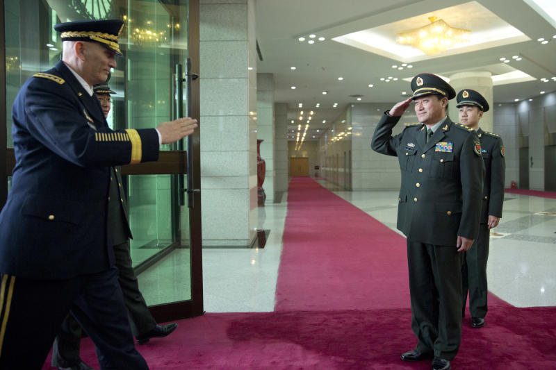 U.S. Army Chief of Staff Gen. Raymond Odierno, left, is saluted by Gen. Wang Ning, right, deputy Chief Staff of the People's Liberation Army (PLA), upon his arrival at China's Ministry of Defense in Beijing, Friday, Feb. 21, 2014. The U.S. Army chief met with top Chinese generals in Beijing Friday amid regional tensions and efforts to build trust between the two nation's militaries. (AP Photo/Alexander F. Yuan, Pool)